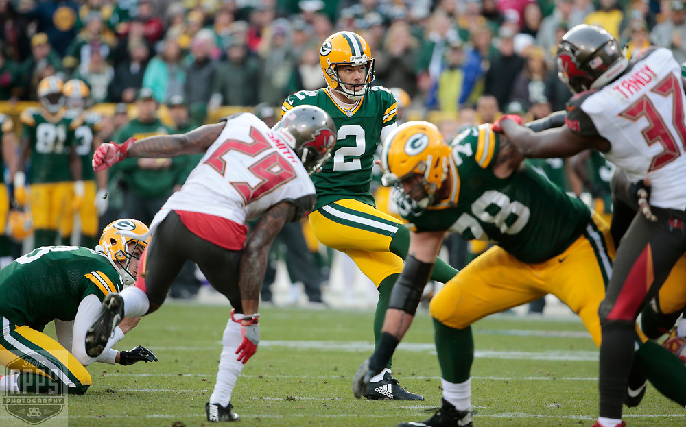 Green Bay Packers kicker Mason Crosby (2) kicks a 22-yard field goal to tie the game at 20 late in the 4th quarter. <br /> The Green Bay Packers hosted the Tampa Bay Buccaneers at Lambeau Field in Green Bay,  Sunday, Dec. 3, 2017. The Packers won in 26-20 in Overtime.   STEVE APPS FOR THE STATE JOURNAL.