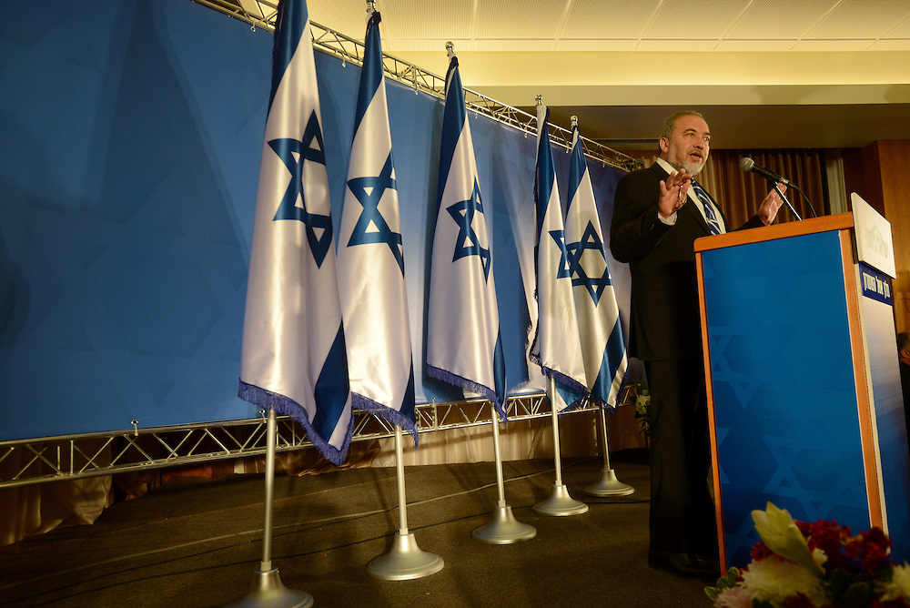 Leader of the Israeli 'Yisrael Beytenu' political party and Israeli Minister of Foreign Affairs Avigdor Lieberman speaks at a conference of Yisrael Beytenu party activists in Ariel, on December 30, 2014. Photo by Gili Yaari