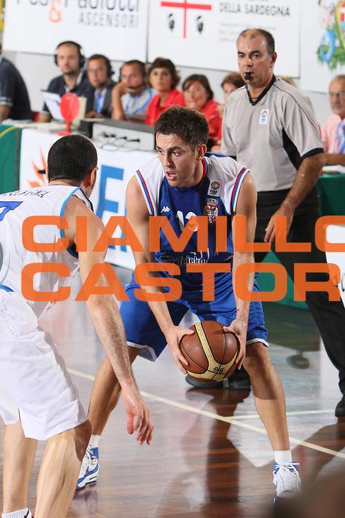 DESCRIZIONE : Cagliari Qualificazione Eurobasket Man 2009 Italia Serbia <br /> GIOCATORE : Milos Vujanic<br /> SQUADRA : Serbia<br /> EVENTO : Raduno Collegiale Nazionale Maschile<br /> GARA : Italia Italy Serbia <br /> DATA : 20/08/2008 <br /> CATEGORIA : Tiro <br /> SPORT : Pallacanestro <br /> AUTORE : Agenzia Ciamillo-Castoria/C. De Massis<br /> Galleria : Fip Nazionali 2008 <br /> Fotonotizia : Cagliari Qualificazione Eurobasket Men 2009 Italia Serbia<br /> Predefinita :