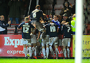 Goal.  Luton celebrate after scoring an injury time winner during the Sky Bet League 2 match between Exeter City and Luton Town at St James' Park, Exeter, England on 19 December 2015. Photo by Graham Hunt.
