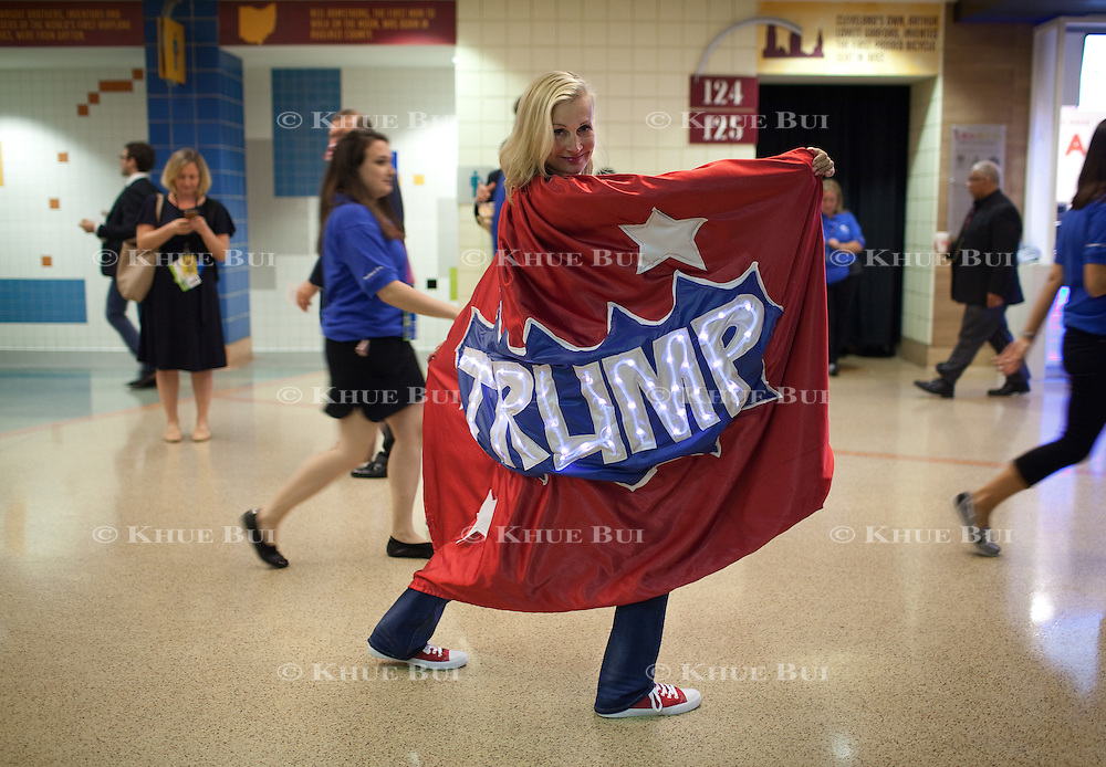 Mary Susan Rehrer, a state delegate from Minnesota, shows off her Trump cape at the Republican National Convention Tuesday, July 19, 2016, in Cleveland, OH.  A friend made the cape for her after Rehrer dreamed of it one night.<br /> <br /> Photo by Khue Bui for Yahoo News.