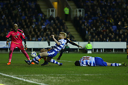 Yoan Gouffran of Newcastle United stretches for the ball but is beaten by Paul McShane of Reading - Mandatory by-line: Jason Brown/JMP - 07/03/2017 - FOOTBALL - Madejski Stadium - Reading, England - Reading v Newcastle United - Sky Bet Championship