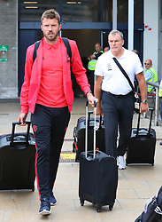 Michael Carrick (left) and Henry Kirkland is spotted at the Manchester Airport, UK as the Manchester United Football Club return from their USA Pre-Season tour on July 1, 2018.