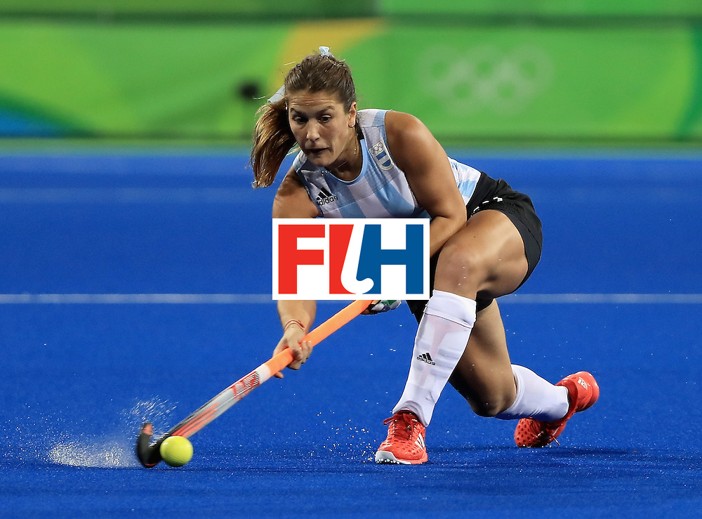 RIO DE JANEIRO, BRAZIL - AUGUST 11:  Julie Gomes #29 of Argentina makes a pass during a Women's Preliminary Pool B match against Australia at the Olympic Hockey Centre on August 11, 2016 in Rio de Janeiro, Brazil.  (Photo by Sam Greenwood/Getty Images)