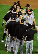 June 14 2011; Phoenix, AZ, USA; San Francisco Giants closing pitcher .Brian Wilson (38) is congratulated by teammates after defeating the Arizona Diamondbacks at Chase Field. The Giants defeated the Diamondbacks 6-5.  Mandatory Credit: Jennifer Stewart-US PRESSWIRE..