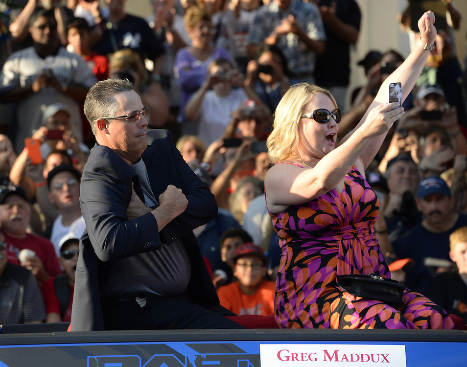 COOPERSTOWN, NY - JULY 26:  2014 Hall of Fame inductee Greg Maddux has some fun with his wife during the annual Parade of Legends down Main Street in Cooperstown, New York on July 26, 2014.