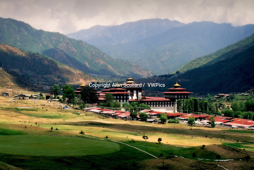 Thimpu Dzong (temple) and golf course. Digitally Manipulated Image. Stylised by enhancing color, sharpening and adding texture.