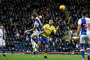 Leeds United midfielder Kemar Roofe (7)  and Blackburn Rovers Defender , Charlie Mulgrew (14) battle during the EFL Sky Bet Championship match between Blackburn Rovers and Leeds United at Ewood Park, Blackburn, England on 2 February 2017. Photo by Pete Burns.