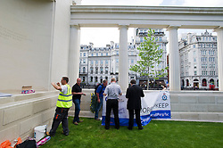 "© London News Pictures. 05/06/2013. London, UK. Repair work being carried out on the The RAF Bomber Command Memorial in London's Green Park which has been vandalised for a second time. Last week the word ""Islam"" was sprayed onto the memorial in the aftermath of the killing of Drummer Lee Rigby in Woolwich.. Photo credit: Ben Cawthra/LNP"