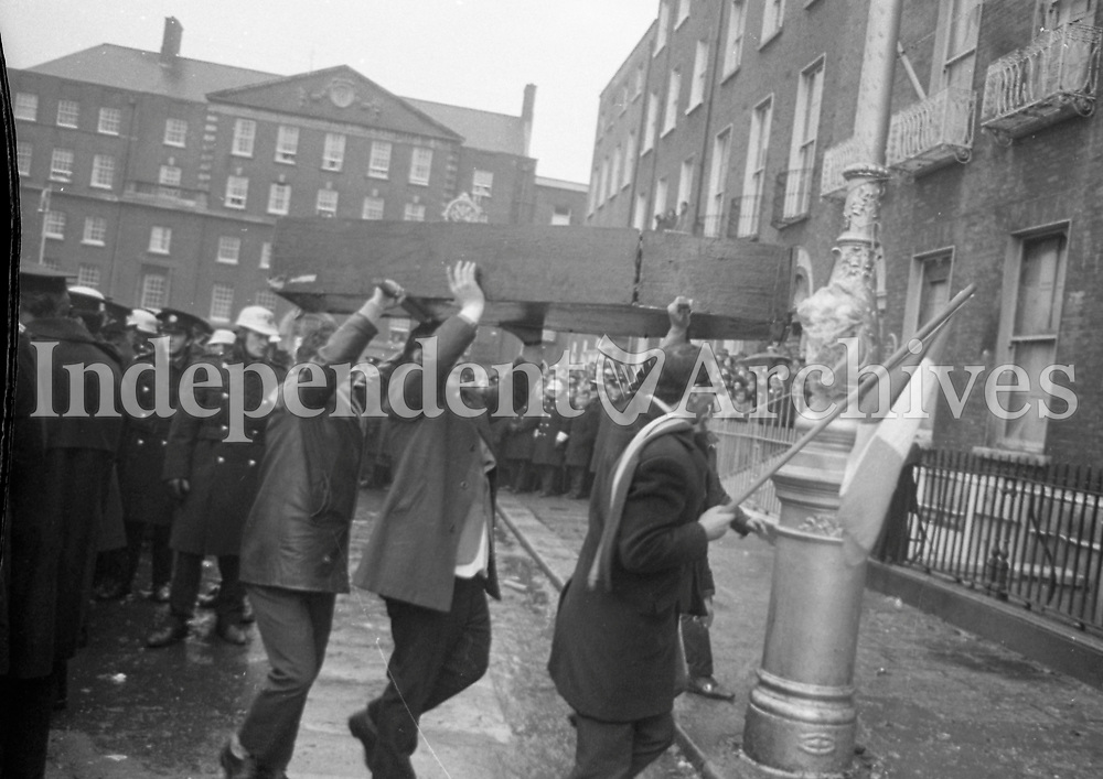Protesters bringing a mock coffin march to the burnt-out British Embassy on Merrion Square that had been destroyed in the protests the  previous  night. The protests were held following Bloody Sunday. February 1972. (Part of the Independent Newspapers/NLI Collection)