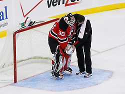 Nov 1, 2008; Newark, NJ, USA; Nov 1, 2008; Newark, NJ, USA; New Jersey Devils goalie Martin Brodeur (30) has a trainer check his left arm after injuring it making a save during the second period at the Prudential Center. Brodeur (30) would leave the game and be replaced by New Jersey Devils goalie Kevin Weekes (1).