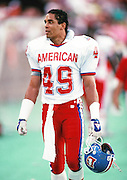 Denver Broncos defensive back Dennis Smith (49) looks on during the 1990 NFL Pro Bowl between the National Football Conference and the American Football Conference on Feb. 4, 1990 in Honolulu. The NFC won the game 27-21. (©Paul Anthony Spinelli)