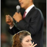 Greenville business owner Delia Liuzza signs for Presedential candidate Barack Obama's speech Thursday at Minges Coliseum in Greenville. (Jason A. Frizzelle)