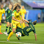 GRENOBLE, FRANCE June 18.  Toriana Patterson #19 of Jamaica defends against Chloe Logarzo #6 of Australia during the Jamaica V Australia, Group C match at the FIFA Women's World Cup at Stade des Alpes on June 18th 2019 in Grenoble, France. (Photo by Tim Clayton/Corbis via Getty Images)
