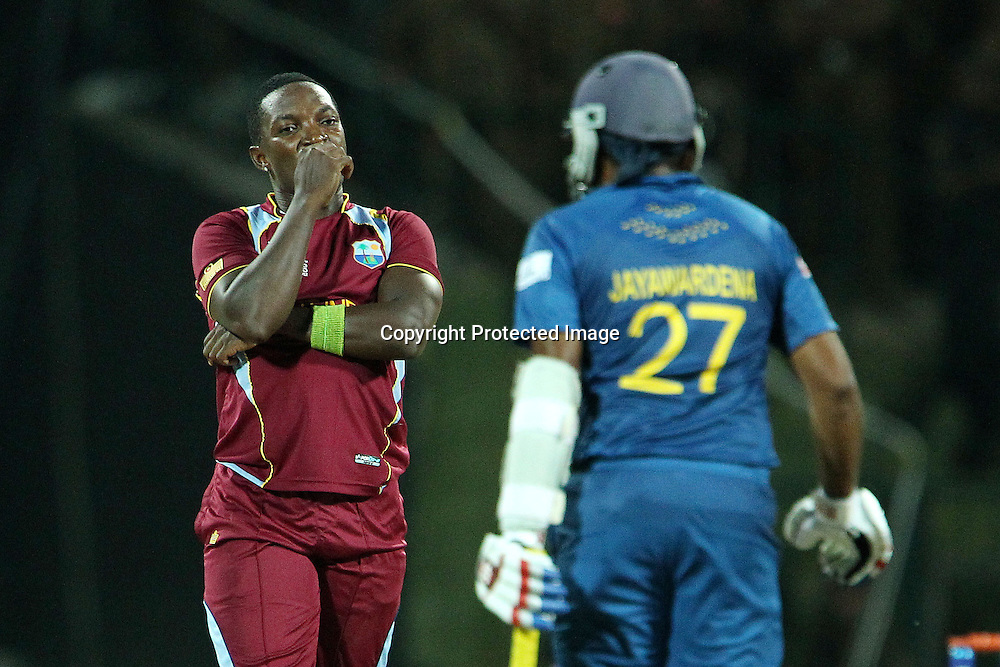 Fidel Edwards of The West Indies reacts after Mahela Jayawardene knocks him to the boundary during the ICC World Twenty20 Super 8s match between Sri Lanka and The West Indies held at the  Pallekele Stadium in Kandy, Sri Lanka on the 29th September 2012<br /> <br /> Photo by Ron Gaunt/SPORTZPICS