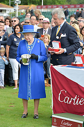 HM THE QUEEN and ARNAUD BAMBERGER at the Cartier Queen's Cup Final polo held at Guards Polo Club, Smith's Lawn, Windsor Great Park, Egham, Surrey on 15th June 2014.