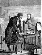 Hans Christian Oersted (1777-1851) German physicist, discovering that electric current has an effect on magnetic needle. Wood engraving c1880.