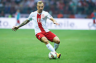 Poland's Kamil Grosicki controls the ball during the EURO 2016 qualifying match between Poland and Germany on October 11, 2014 at the National stadium in Warsaw, Poland<br /> <br /> Picture also available in RAW (NEF) or TIFF format on special request.<br /> <br /> For editorial use only. Any commercial or promotional use requires permission.<br /> <br /> Mandatory credit:<br /> Photo by © Adam Nurkiewicz / Mediasport