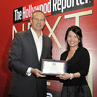 HONG KONG - MARCH 24:  Hollywood Reporter's Senior VP, Publishing Director Eric Mika (L) and Grace Chen during The Hollywood Reporter Next Gen Asia Launch Cocktail Reception event at the W Hotel Kowloon on March 24, 2009 in Hong Kong. The initiative has recognised over 500 individuals under 35 over the last 15 years, and is run in conjunction with the Hong Kong International Film Festival.  Photo by Victor Fraile / studioEAST