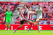 Christian Burgess (#6) of Portsmouth FC clears the ball during the EFL Sky Bet League 1 match between Sunderland and Portsmouth at the Stadium Of Light, Sunderland, England on 17 August 2019.