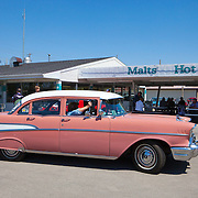 A '57 Chevrolet at the Polk-a-Dot drive in on historic U.S. Route 66. The Mother Road  starts in Chicago traveling through 6 states and ending in Santa Monica, California.<br /> Photography by Jose More