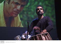 Karsh Kale, an undisputed force of nature on the tablas, performs an original live music score to a screening of Bruce Lee's cult classic: Enter the Dragon. ..London born and New York raised, Kale balances his Indian heritage with rock 'n' roll, hip-hop and atmospheric pop to create his eclectic style of music. When setting out to create this powerful music piece, Kale enlisted the help of Midival Punditz - the first Indian electronic band to break into the international scene. Released in 1973, Enter the Dragon is the last feature film Lee appeared in before his death.