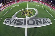 The NFL Divisional playoff logo is painted on the field grass for the Arizona Cardinals NFL NFC Divisional round playoff football game against the Green Bay Packers on Saturday, Jan. 16, 2016 in Glendale, Ariz. The Cardinals won the game in overtime 26-20. (©Paul Anthony Spinelli)