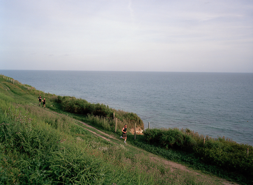 The spectacular route on the cliffs east of Brighton commonly inspires hiking cycling and running. There's a path designed to encourage all of these disciplines, although these runners preferred a trail closer to the edge, presumably for it's stunning views.