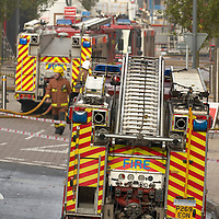Fire engines by cordoned area at fire scene<br />