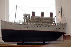 model of a ship sitting on a window sill