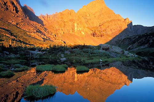 The first light of day illuminates 14,000 foot Crestone Needle in the Sangre de Cristo Mountains.