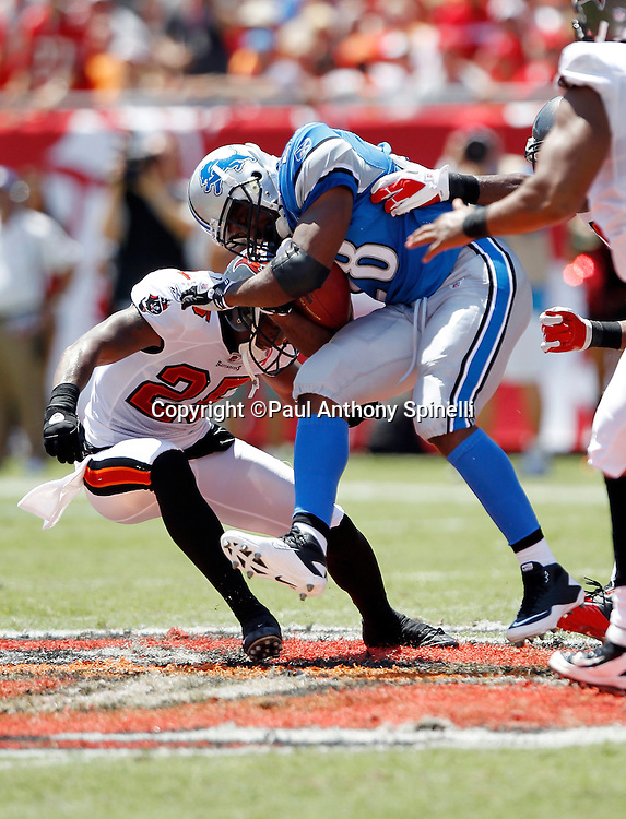 Detroit Lions running back Maurice Morris (28) gets hit by Tampa Bay Buccaneers  cornerback Ronde Barber (20) during the NFL week 1 football game against the Tampa Bay Buccaneers on Sunday, September 11, 2011 in Tampa, Florida. The Lions won the game 27-20. ©Paul Anthony Spinelli