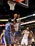 Feb. 4, 2012; Phoenix, AZ, USA; Charlotte Bobcats forward Tyrus Thomas(12) puts up a shot against the Phoenix Suns guard Josh Childress (1) during the first half at the US Airways Center. Mandatory Credit: Jennifer Stewart-US PRESSWIRE.