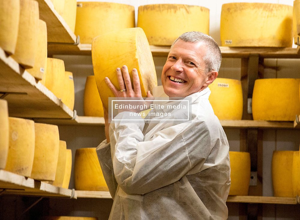 Scottish Lib Dem leader Willie Rennie gets to grips with one of the cheeses when he visited St Andrews Farmhouse Cheese Company in Pitenweem in Fife in the run up to the 2017 General Election.<br /> <br /> © Dave Johnston/ EEm
