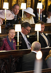 The Princess Royal talks to the Duke of York (back to camera) as she sits alongside Sir Timothy Laurence in St George's Chapel at Windsor Castle ahead of the wedding of Prince Harry and Meghan Markle.
