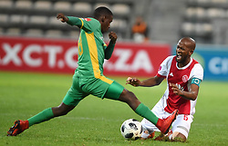 Cape Town-180424 Ajax Cape Town defender  Mosa Lebusa challenged by Baroka midfielder  Mduduzi Mdantsane  In a PSL game at   at Athlone stadium.photographer:Phando Jikelo/African News Agency/ANA