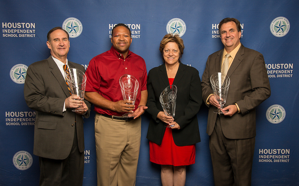 L-R: IPAA President & CEO Barry Russell, Target Group Vice-President for South Texas Dell McKinney, Houston Astros Senior Vice President for Community Relations Meg Vaillancourt and Houston Food Bank President & CEO Brian Greene pose with a Hall of Fame trophy following the Houston ISD Partnership Appreciation breakfast at Kingdom Builders, October 25, 2013.