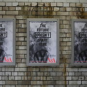 Greenpeace subverts the opening of The Future Starts Here at the V&A Museum because the exhibition is sponsored by the car company Volkswagen, May 9th 2018, London, United Kingdom. Activists change the posters with their own The Future Doesnt Start Here, hand out flyers and dismantled a VW diesel car putting the engine bits inside the museum court yeard. Greepeace is protesting against Volswagen's continued production and promotion of polluting diesel cars.