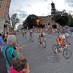 The Iron Hill Twilight Criterium Pro Men's race passes by the Historic Chester County courthouse in West Chester. TK4