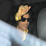 04.JULY.2011. LONDON<br /> <br /> SUPER STAR PRINCE LEAVES CLARIDGES HOTEL WITH A MYSTERY WOMAN IN CENTRAL LONDON VIA THE GOODS INWARD ENTRANCE AT 1AM WEARING BIZARRE MOON SHAPED EARRINGS AND OTHER PIECES OF BLING.<br /> <br /> BYLINE: EDBIMAGEARCHIVE.COM<br /> <br /> *THIS IMAGE IS STRICTLY FOR UK NEWSPAPERS AND MAGAZINES ONLY*<br /> *FOR WORLD WIDE SALES AND WEB USE PLEASE CONTACT EDBIMAGEARCHIVE - 0208 954 5968*