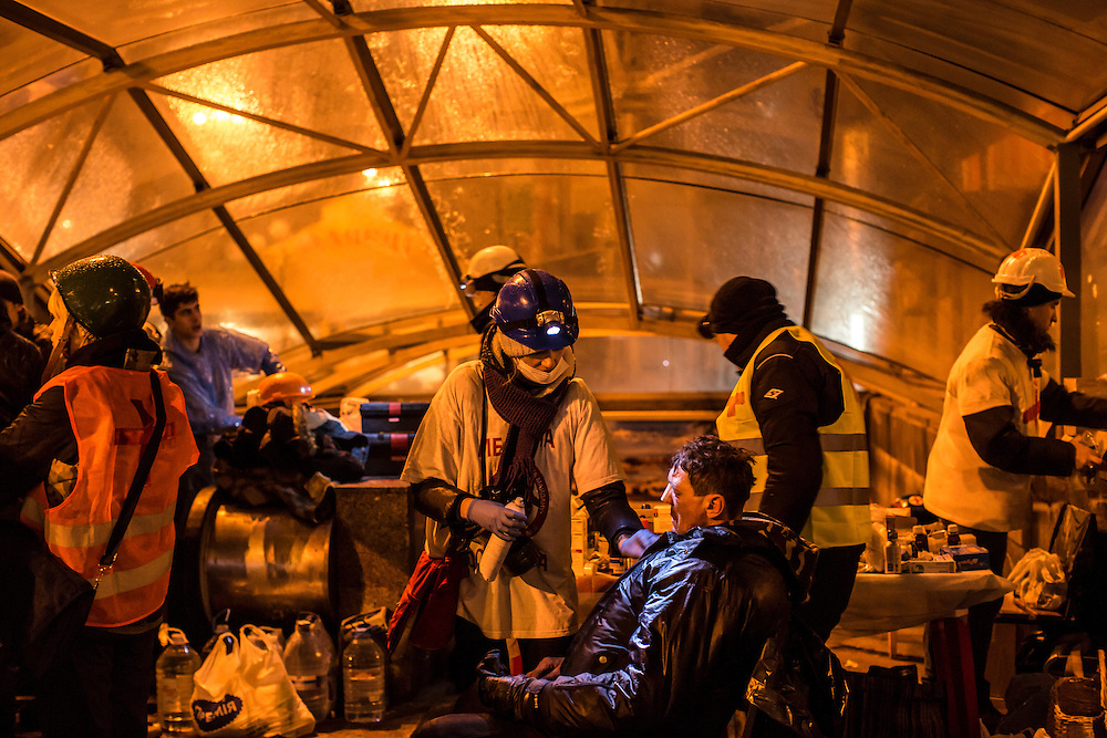 KIEV, UKRAINE - FEBRUARY 19: Medical volunteers treat an injured anti-government protester in a makeshift clinic near Independence Square on February 19, 2014 in Kiev, Ukraine. After several weeks of calm, violence has again flared between anti-government protesters and police as the Ukrainian parliament is meant to take up the question of whether to revert to the country's 2004 constitution. (Photo by Brendan Hoffman/Getty Images) *** Local Caption ***