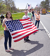 Hurley, New York  - People hold American flags along Route 209 to honor U.S. Army Sgt. Shawn M. Farrell II on May 7, 2014. Farrell died April 28 when forces attacked his unit with small arms fire in Afghanistan.