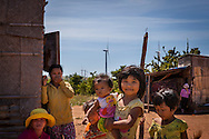 Children gather beside a dwelling on a windfarm in Ninh Thuan Province, Vietnam<br /> , Southeast Asia