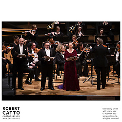 Singers Roger Wilson, Richard Greager and Jenny Wollerman share the stage with the Vector Wellington Orchestra and conductor Marc Taddei in a performance entitled Music That Moves, at the Wellington Town Hall, Wellington New Zealand.