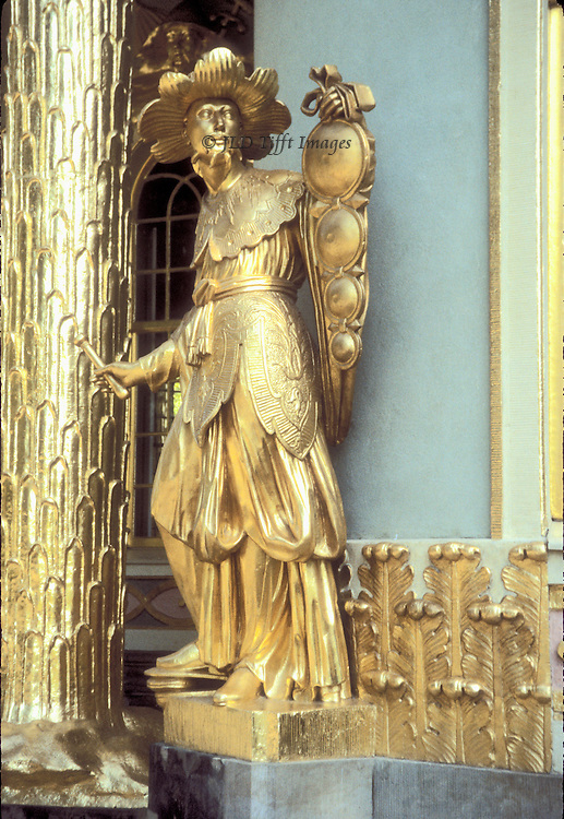Gilded figure of a robed musician holding gongs, on the facade of the Japanese Tea House on the grounds of Frederick the Great's palace Sanssouci in Potsdam, Germany.