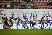 Ipswich's Tom Lawrence (27) shoots from the free kick during the EFL Sky Bet Championship match between Wigan Athletic and Ipswich Town at the DW Stadium, Wigan, England on 17 December 2016. Photo by Craig Galloway.