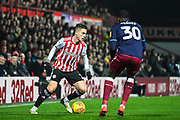 Brentford Forward Sergi Canos (7) and Aston Villa Defender Kortney Hause (30) in action during the EFL Sky Bet Championship match between Brentford and Aston Villa at Griffin Park, London, England on 13 February 2019.