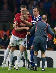 MOSCOW, RUSSIA - Wednesday, May 21, 2008: Manchester United's Nemanja Vidic is held back by Michael Carrick after fighting with Chelsea players during the UEFA Champions League Final at the Luzhniki Stadium. (Photo by David Rawcliffe/Propaganda)