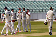 Paul Coughlin (Durham County Cricket Club)  celebrates with team mates after taking the wicket of Lewis Gregory (Somerset County Cricket Club)in action during the LV County Championship Div 1 match between Durham County Cricket Club and Somerset County Cricket Club at the Emirates Durham ICG Ground, Chester-le-Street, United Kingdom on 9 June 2015. Photo by George Ledger.