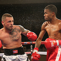 Michael Ramos (L) fights against Anthony Arvelo during a Telemundo boxing match at the Kissimmee Civic Center on Friday, July 17, 2015 in Kissimmee, Florida.  Ramos won the bout. (AP Photo/Alex Menendez)